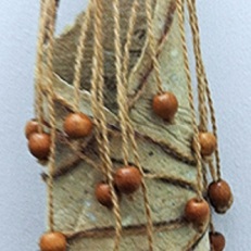 """Message: Creativity means expressing what you don't know, handmade paper, wool, wood beads, 11.75""""H"""
