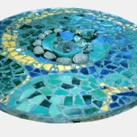 Table top, tiles, broken pottery, rocks, 1 metre diameter