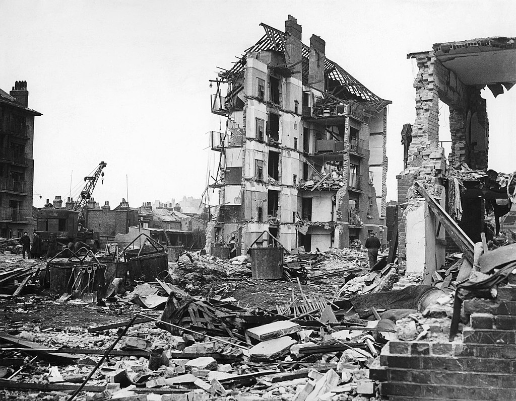 1024px-Damage_Caused_by_V2_Rocket_Attacks_in_Britain,_1945_HU88803